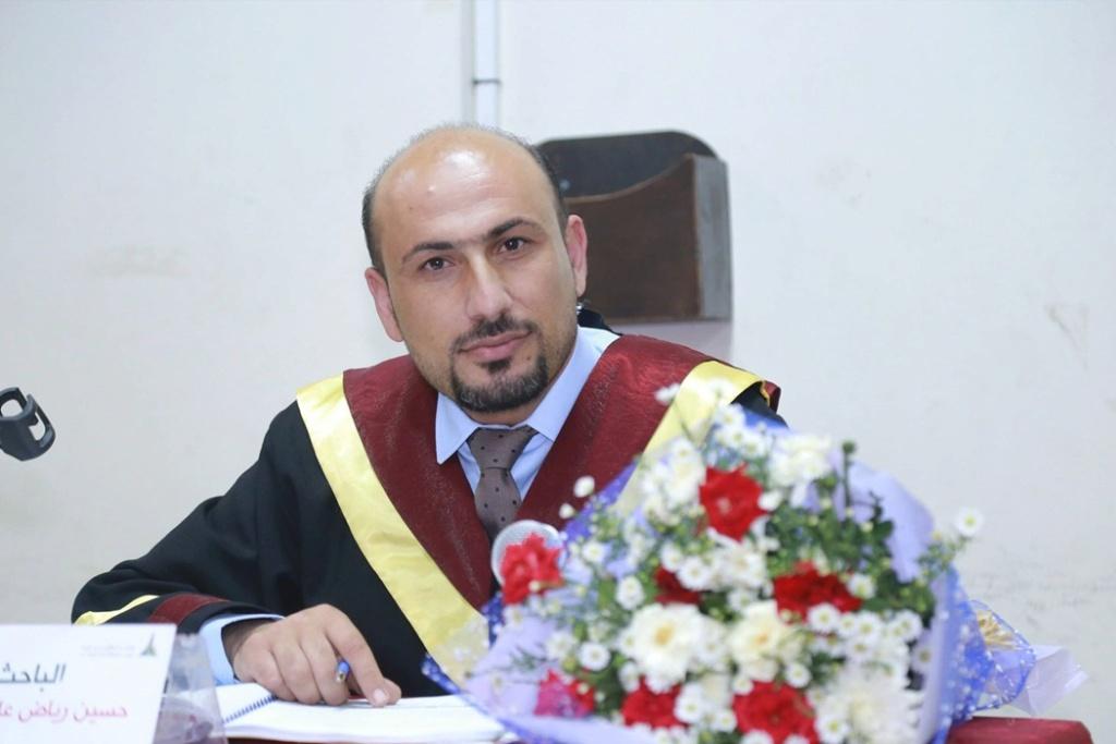 جامعة الأقصى تمنح الباحث حسين 39343310.jpg